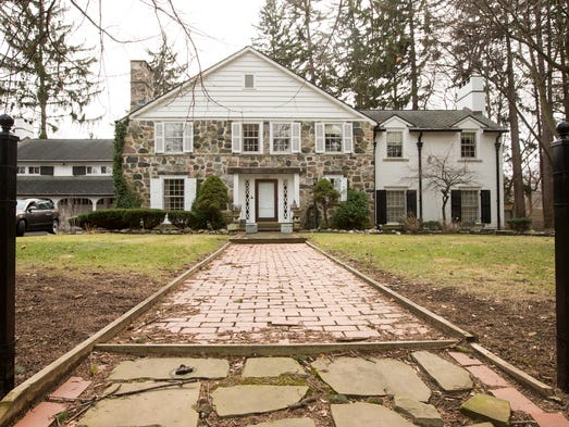 This stately stone-front house is rich with vintage