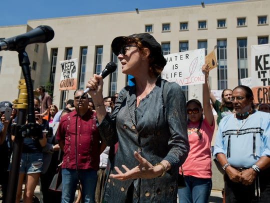 Actress Susan Sarandon speaks at a rally outside the