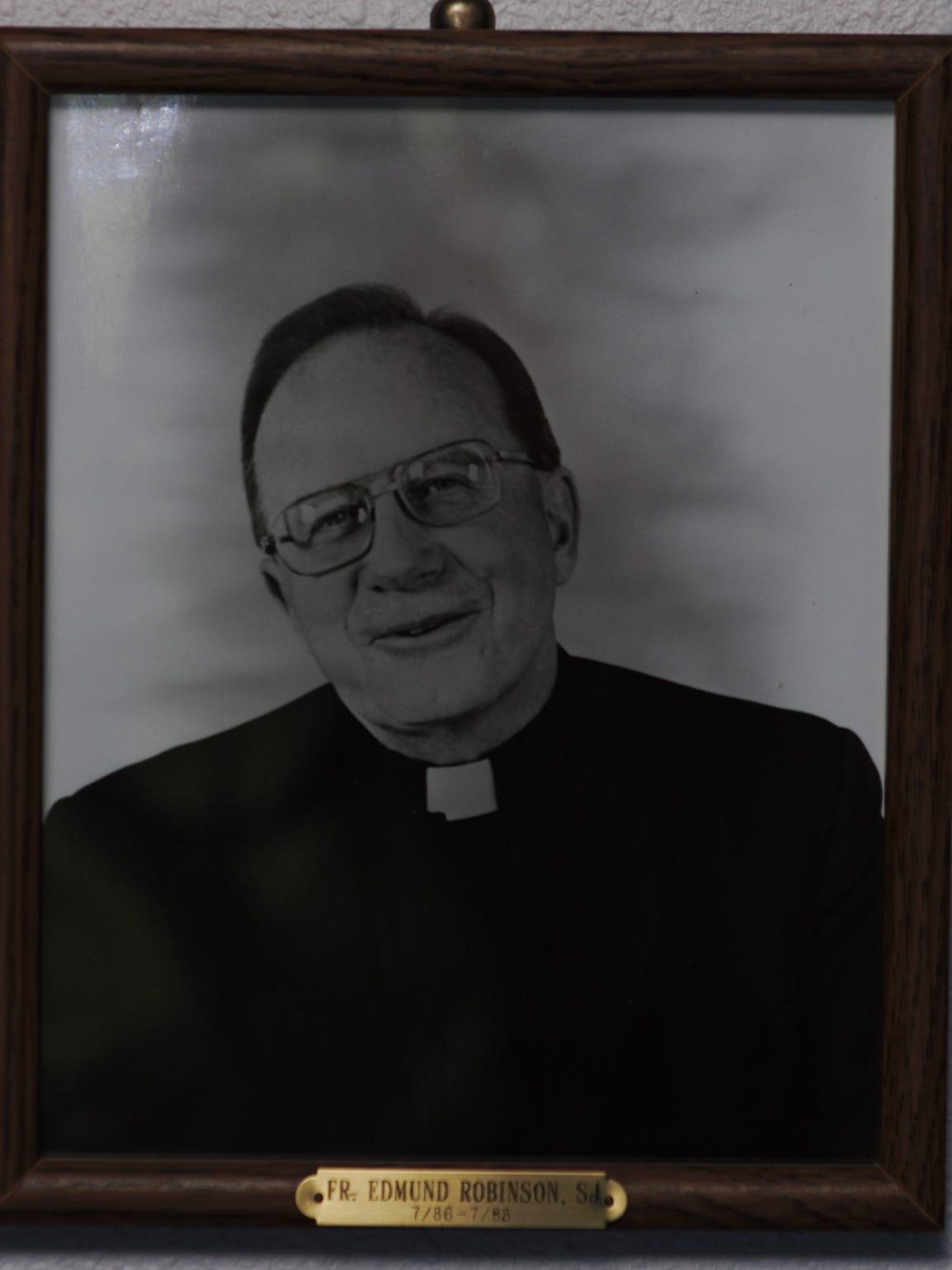 Father Edmund Robinson's portrait adorns a basement