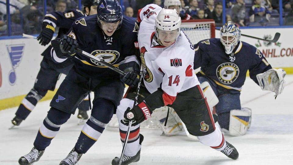 The Ottawa Senators' Colin Greening (14) battles for