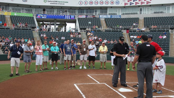 The News-Press Insiders (subscribers) surround home plate as the Fort Myers Miracle prepare to compete against the Palm Beach Cardinals in July of 2015 at Hammond Stadium. The News-Press Insiders were able to experience the game as a sports journalist would by receiving press passes, spending time in the press box, broadcast booth, on the field, and in the photo well. Go to news-press.com/insider to learn about this year's event our subscriber exclusive events.