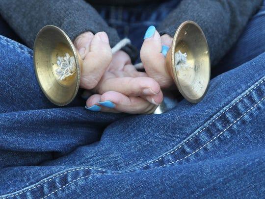 Stacy Sims holds meditation chimes during a meditation