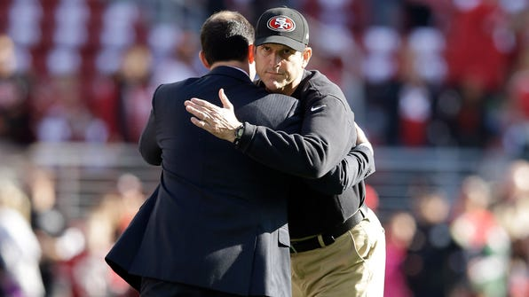 SANTA CLARA, CA - DECEMBER 28:  Head coach Jim Harbaugh of the San Francisco 49ers hugs 49ers owner Jed York before their game against the Arizona Cardinals at Levi's Stadium on December 28, 2014 in Santa Clara, California.  (Photo by Ezra Shaw/Getty Images) ORG XMIT: 507872867 ORIG FILE ID: 460874300