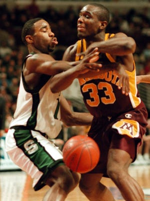 MSU'S Mateen Cleaves blocks a pass by Minnesota's Eric Harris during the first Big Ten Tournament at the United Center in Chicago, March 6, 1998.