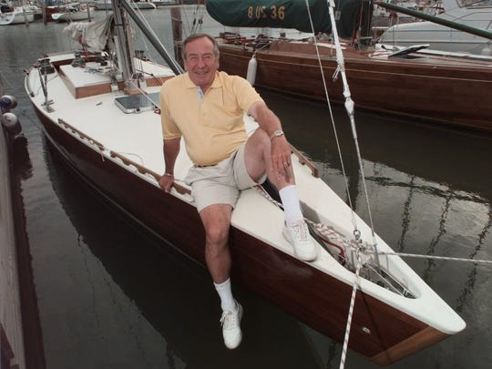 """Harry Voss with his boat the """"Golden Feather"""" in 1998."""