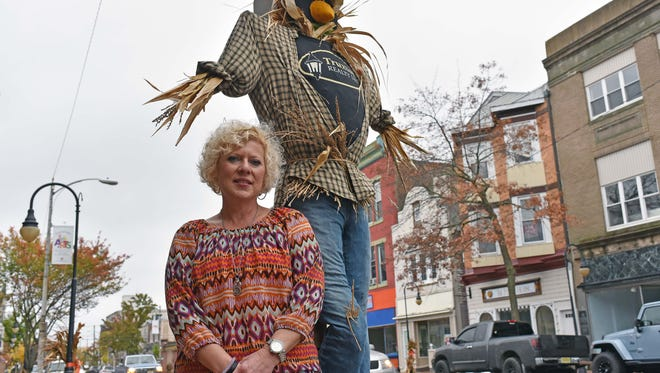 Jennifer Truxton of Truxton Realty in Millville won the 2015 Best Business Scarecrow Award for this scarecrow on High Street. She and her husband made the scarecrow.