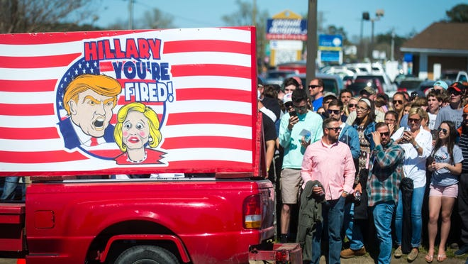 Donald Trump supporters wait to cross the street prior to a rally held at Stephen Decatur High School on Wednesday in Berlin.