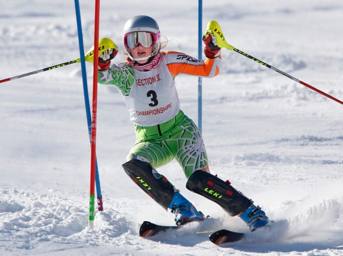 Maddy Haggerty, from Victor, leads her team during the afternoon slalom run at the Section V Girls Skiing Championships. Victor won top team honors.