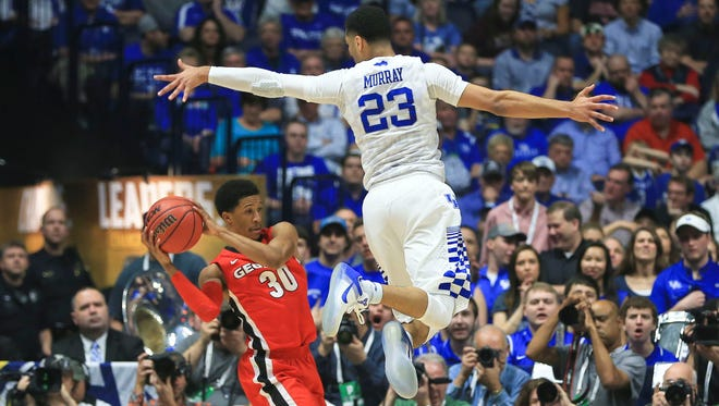 Kentucky's Jamal Murray pressures Georgia's J.J. Frazier in the first half as Kentucky came back in the second half to win 93-80 in the SEC semifinal game.