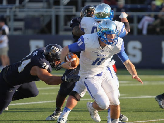 A.J. Erdely, quarter back for MTSU, escapes tackle