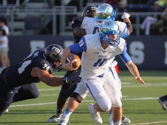 A.J. Erdely, quarter back for MTSU, escapes tackle during Saturday's game against the FIU Panthers.