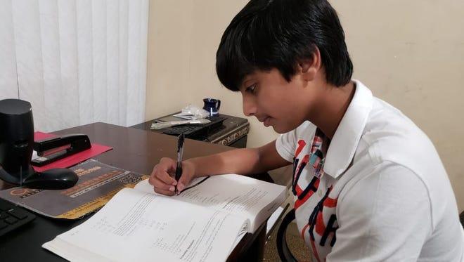 Noyal Joby works to get back into the mindset of school days.