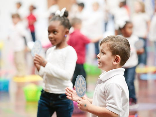 """Students perform during the Truman Early Childhood Education Center performance of """"The Wonderful World of Winter,"""" as part of the Acadiana Symphony Orchestra's Do-Re-ME program, in Lafayette Tuesday, Jan. 24, 2017."""
