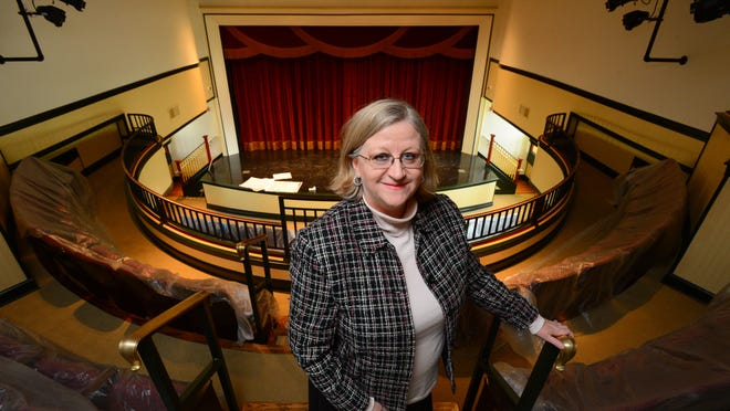 Suzanne Sims stands in the balcony of the theater at McCandless Hall at Athens State University in Athens, Ala.