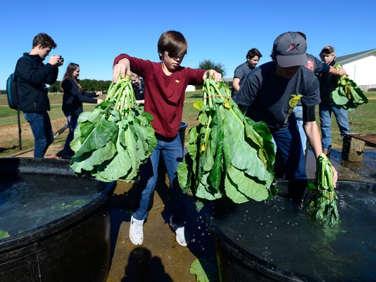 Students learn farming while helping those in need