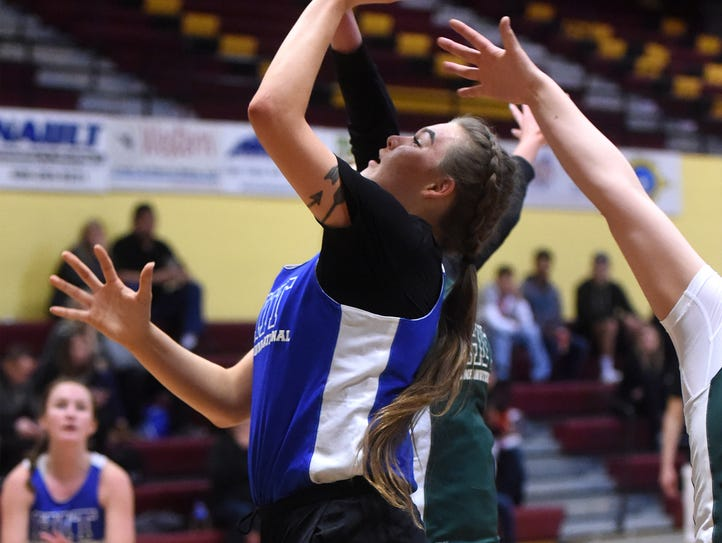The Cass B blue team's Imani Bighorn shoots in their