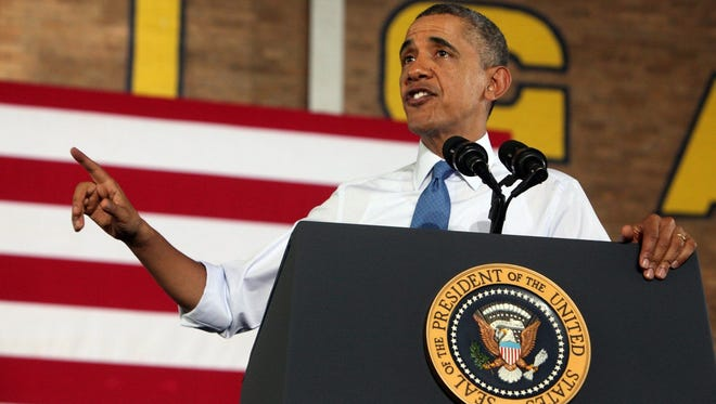 President Obama speaks to hundreds of Michigan students packed into an intramural gym on the campus of the University of Michigan in Ann Arbor on Wednesday, April 2, 2014. Eric Seals/Detroit Free Press