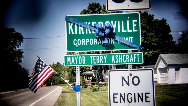 Jessica Phelps/The Advocate A blue ribbon is tied to a Kirkersville road sign about half a mile outside the town in  remembrance of the shooting victims in last week's attack. A blue ribbon is tied to a Kirkersville road sign about half a mile outside the town in remembrance of the shooting victims in last week's attack.