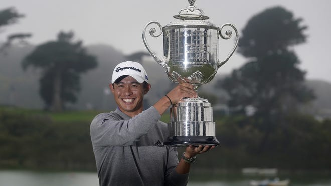 Collin Morikawa holds the Wanamaker Trophy after winning the PGA Championship golf tournament at TPC Harding Park on Sunday.