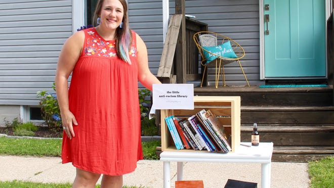 """Cydney Sheneman created """"The Little Anti-Racism Library"""" out of a wooden crate and her own collection of books about race and racism in America. Since then, family and friends have also contributed books to the library outside her family's home in Zeeland."""