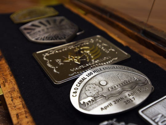 Some of the commemorative belt buckles from Jason Rupe's