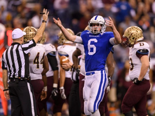 Memorial's Brock Combs (6) motions for the fans to keep cheering during the fourth quarter of the Class 3A State Championship at Lucas Oil Stadium last season.