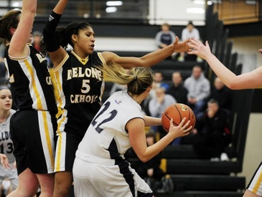 Sierra Moore (5) and Delone Catholic topped West York, 64-49, on Saturday.