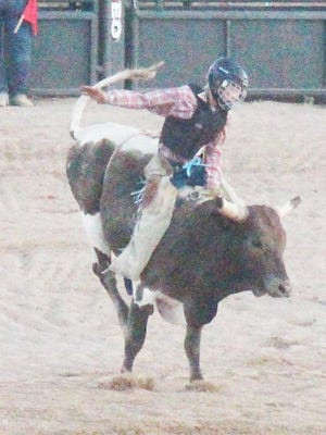 Waitley Sharon of Ordway in senior boys bull riding. Sharon won the event and was also the senior boys all-around champion.