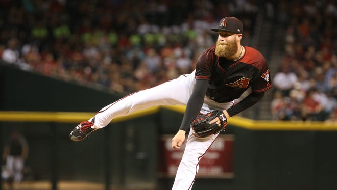 Diamondbacks' Archie Bradley (25) pitches in relief against the Rockies at Chase Field in Phoenix, Ariz. on April 29, 2017.
