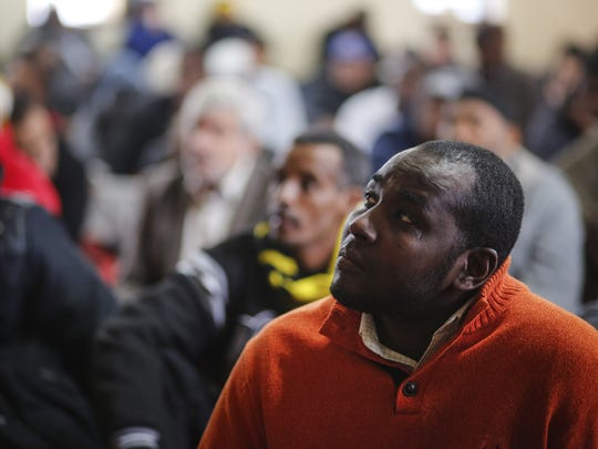 Almardi Abdalla, 39, of Des Moines listens to a sermon at the Masjid An-Noor Mosque in Des Moines Friday, Jan. 8, 2016.