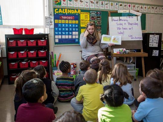 Kindergarten teacher Ashley Bunyan reads a story to