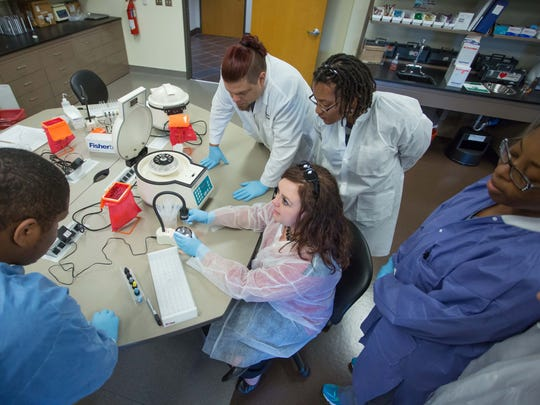 Students learn blood testing techniques in the Vol