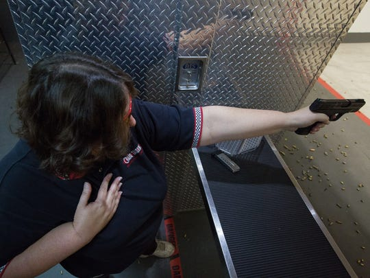 Heather Murphy, co-founder and member of High Caliber Ladies, fires her Smith & Wesson M & P Shield 9 millimeter one handed at Strykers Shooting World, Friday Jan. 13, 2017. The one handed shooting position is one of the skills that the club teaches.