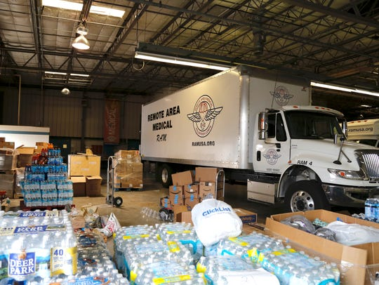Bottled water and other supplies are being accepted