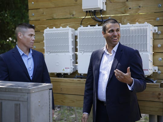 TDS Telecom's Director of Network Architecture and Implementation Benjamin Goth, left, shows FCC Chairman Ajit Pai a fiber optic node, which his agency helped pay for as part of their push to improve broadband speeds in rural areas, during the chairman's visit to Quincy Wednesday.