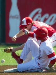 UL's Alex Pinero is safe at second as Sacred Heart's Ted Shaw reaches for the throw in the third inning at The Tigue.