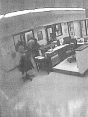 A surveillance image shows the main hallway of Unit 11, where Shields was brought after an argument in the chow hall. The door on the far left opens to the shower room, where there are separate locked stalls.