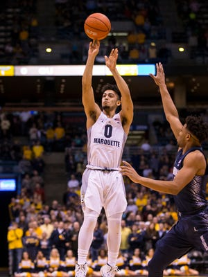 Marquette Golden Eagles guard Markus Howard (0) shoots during the first half against the Georgetown Hoyas at BMO Harris Bradley Center.