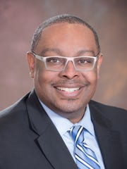 Tony Baltimore, pictured here, is chair of the Lansing Housing Commission board.