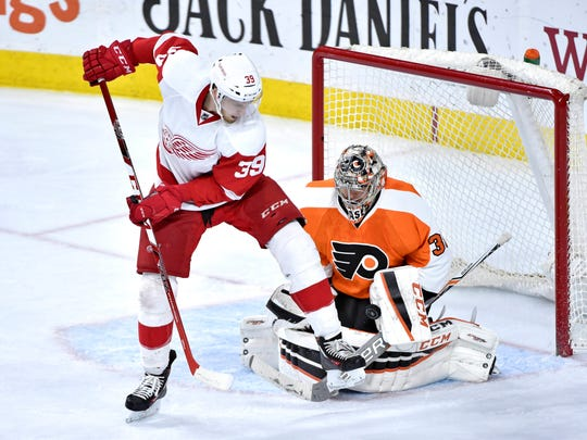 Mar 15, 2016; Philadelphia, PA, USA; Detroit Red Wings right wing Anthony Mantha (39) screens Philadelphia Flyers goalie Steve Mason (35) during the third period at Wells Fargo Center. The Flyers defeated the Red Wings, 4-3.