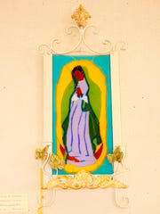 Second place was a fused glass piece of the Virgen