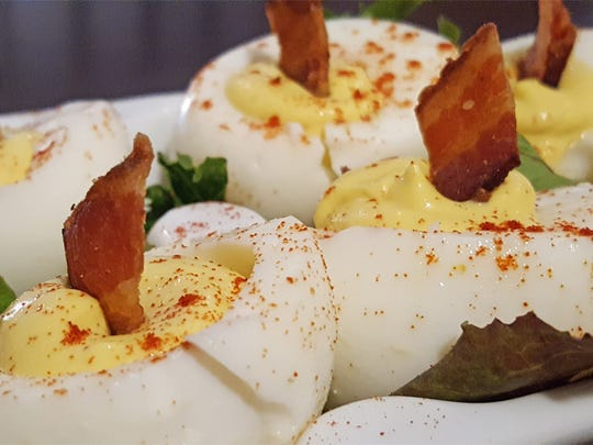 The deviled eggs feature practically the entire egg topped with bacon.