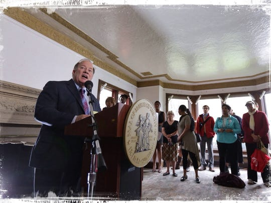Detroit Mayor Mike Duggan talks about one of the  houses to go up for auction in Detroit on May 12 in the Boston Edison neighborhood during a news conference at the 4,200-square-foot home built in 1924.