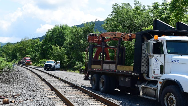 State, local and federal emergency crews respond to a train derailment off of Route 17 in Deposit on Thursday, August 9, 2018. Clean-up will continued in the area for at least a week.