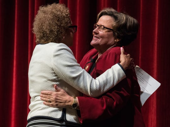 D'Ana Johnson, left, member of the Board of Regents and Salisbury University president Janet Dudley-Eshbach embrace during a ceremony introducing the new president Charles Wight at Holloway Hall on Friday, May 4, 2018.