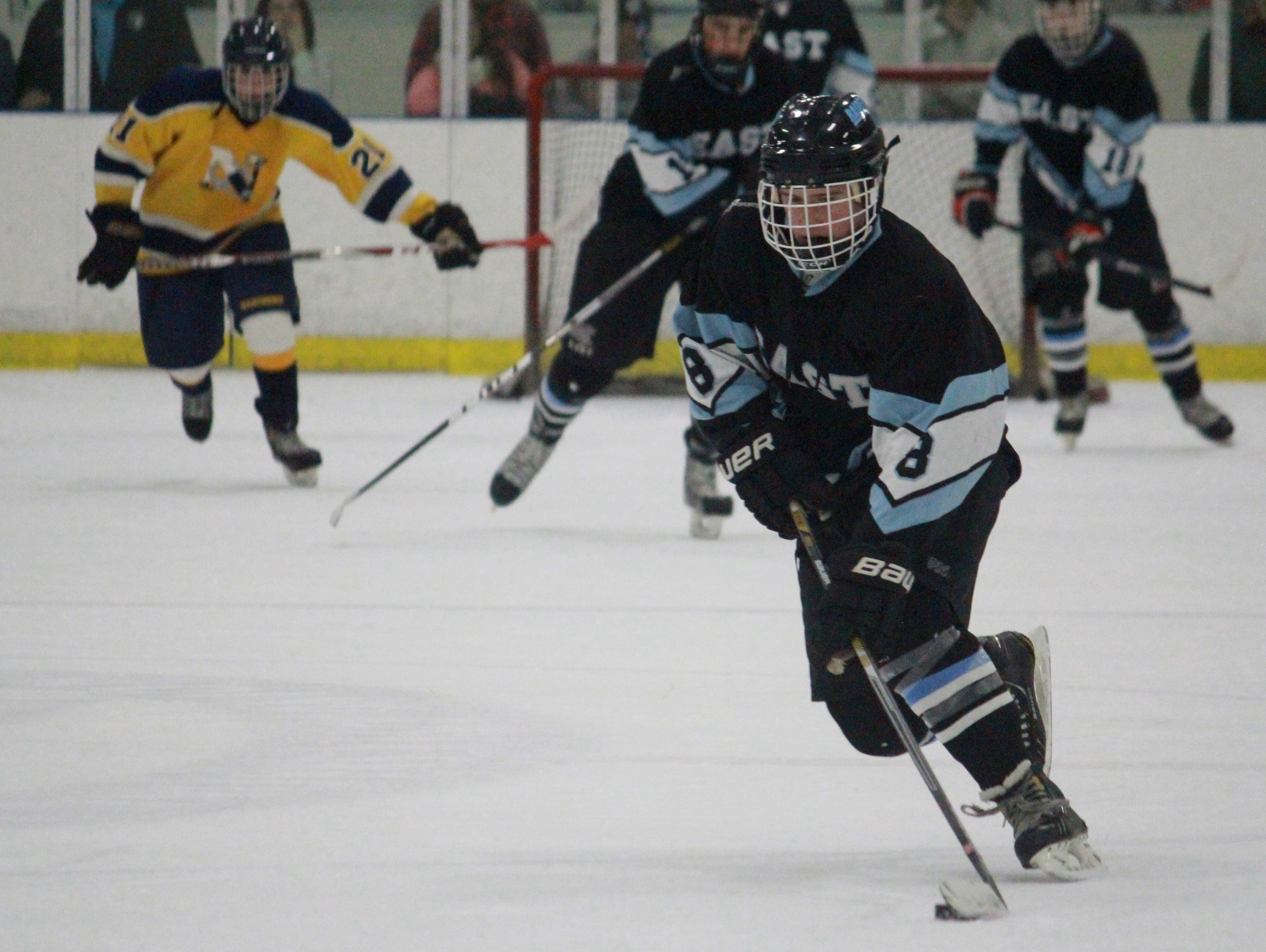 Pat Hoffman carries the puck for Toms River East last year against Toms River North.