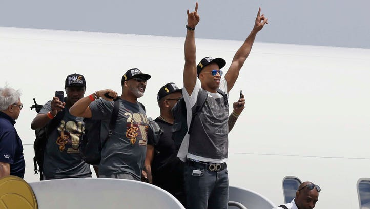 Cleveland Cavaliers' Richard Jefferson raises his arms in celebration after arriving in Cleveland, Monday, June 20, 2016. The Cavaliers defeated Golden State in Game 7 of the NBA Finals on Sunday in Oakland, Calif. (AP Photo/Tony Dejak) ORG XMIT: OHTD107