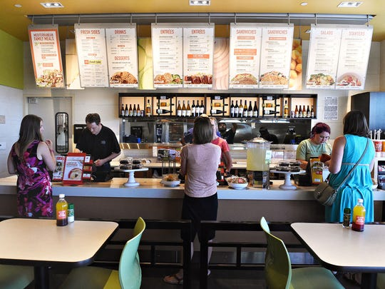 Customers place their orders at Zoes Kitchen on Thursday, June 27, 2016.