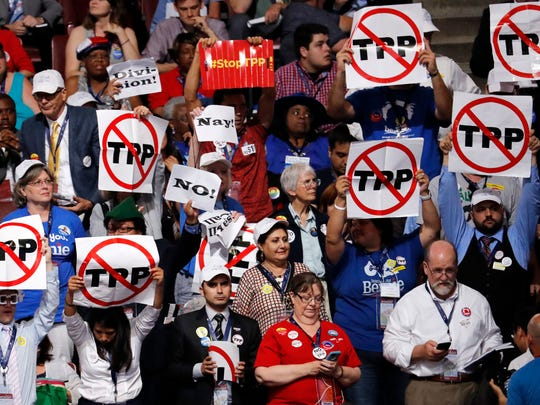 Demonstrators against the Trans Pacific Partnership agreement protest during the first day of the Democratic National Convention in Philadelphia , Monday, July 25, 2016.
