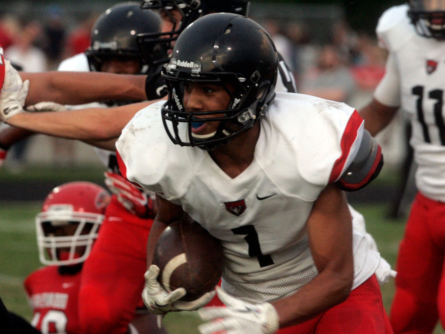Stewarts Creek's Cynterius Lyons returns a kickoff in the first half at Ravenwood Friday, August 23, 2013.